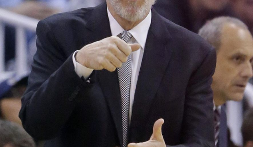 San Antonio Spurs head coach Gregg Popovich directs his team during the second quarter in an NBA basketball game against the Utah Jazz Thursday, Feb. 25, 2016, in Salt Lake City. (AP Photo/Rick Bowmer)
