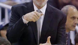 San Antonio Spurs head coach Gregg Popovich directs his team during the second quarter in an NBA basketball game against the Utah Jazz Thursday, Feb. 25, 2016, in Salt Lake City. (AP Photo/Rick Bowmer)