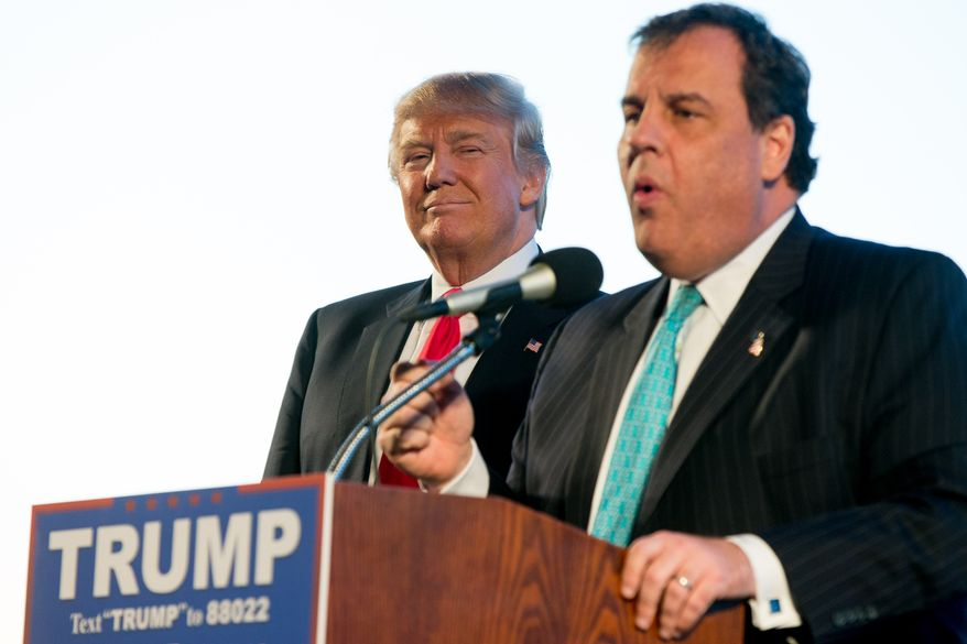 New Jersey Gov. Chris Christie, right, introduces Republican presidential candidate Donald Trump, left, at a rally at Millington Regional Airport in Millington, Tenn., Saturday, Feb. 27, 2016. (AP Photo/Andrew Harnik)