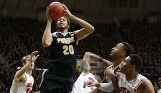 Purdue center A.J. Hammons (20) shoots between Maryland forwards Jake Layman, left, and Jared Nickens, right, Maryland center Diamond Stone, center, and Purdue forward Vince Edwards, second from right, in the second half of an NCAA college basketball game, Saturday, Feb. 27, 2016, in West Lafayette, Ind. (AP Photo/R Brent Smith)