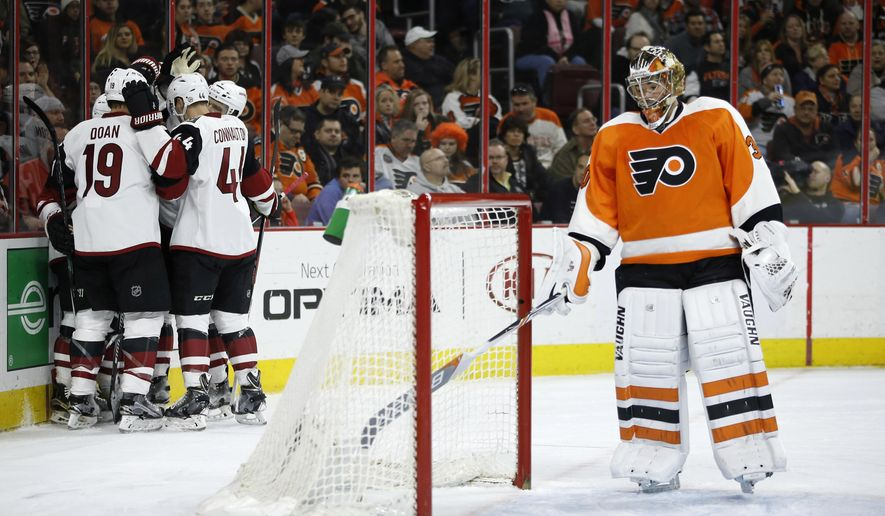Arizona Coyotes' Shane Doan (19) and Kevin Connauton (44) celebrate after a goal by teammate Brad Richardson past Philadelphia Flyers' Michal Neuvirth (30) during the first period of an NHL hockey game, Saturday, Feb. 27, 2016, in Philadelphia. (AP Photo/Matt Slocum)