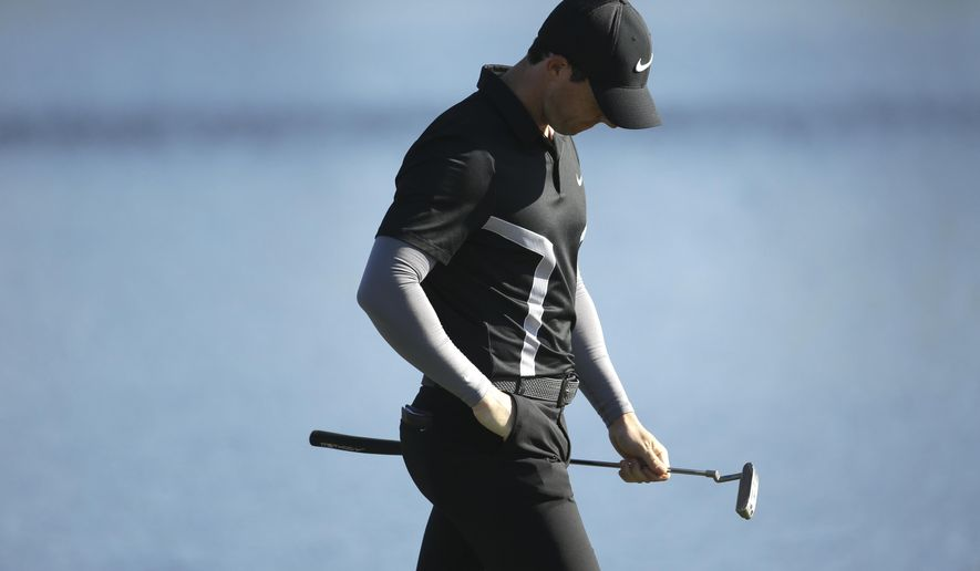 Rory McIlroy, of Northern Ireland, walks from the 14th green during the second round of the Honda Classic golf tournament, Friday, Feb. 26, 2016, in Palm Beach Gardens, Fla. (AP Photo/Lynne Sladky)