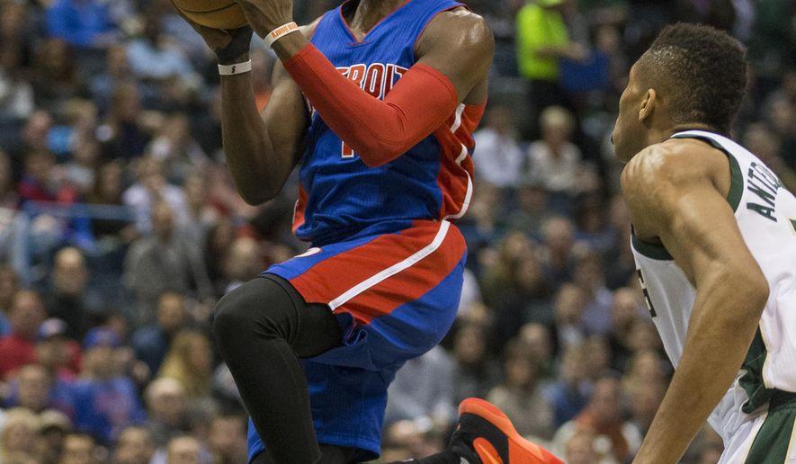 Detroit Pistons' Reggie Jackson, left, drives past Milwaukee Bucks' Giannis Antetokounmpo during the first half of an NBA basketball game Saturday, Feb. 27, 2016, in Milwaukee. (AP Photo/Tom Lynn)