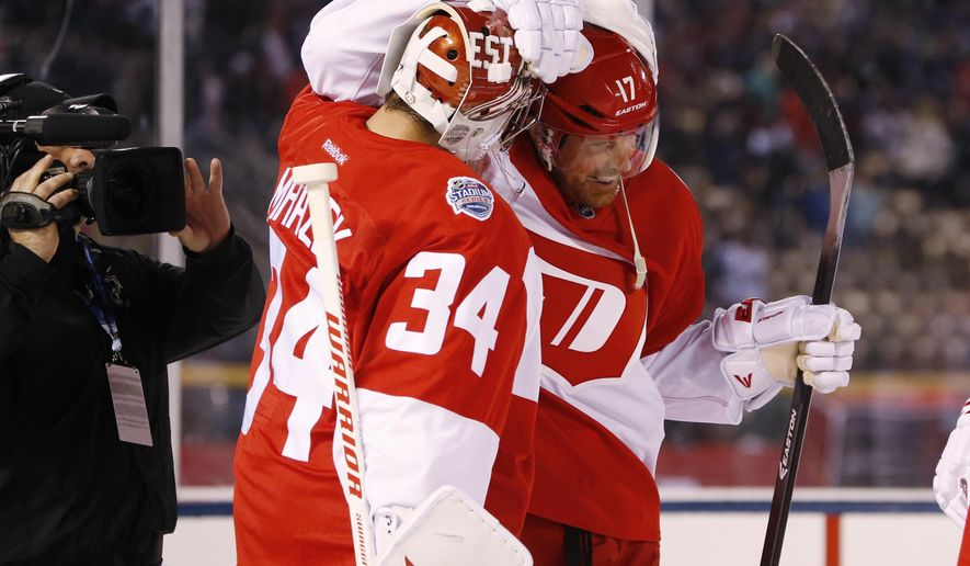 Detroit Red Wings goalie Petr Mrazek (34) celebrates with center Brad Richards after facing the Colorado Avalanche in the third period of an NHL hockey game Saturday, Feb. 27, 2016, in Denver. The Red Wings won 5-3. (AP Photo/David Zalubowski)