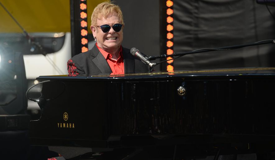 Elton John performs on the Sunset Strip, co-presented by AOL BUILD and BBVA Compass on Saturday, Feb. 27, 2016, in West Hollywood, Calif. (Photo by Evan Agostini/Invision/AP)
