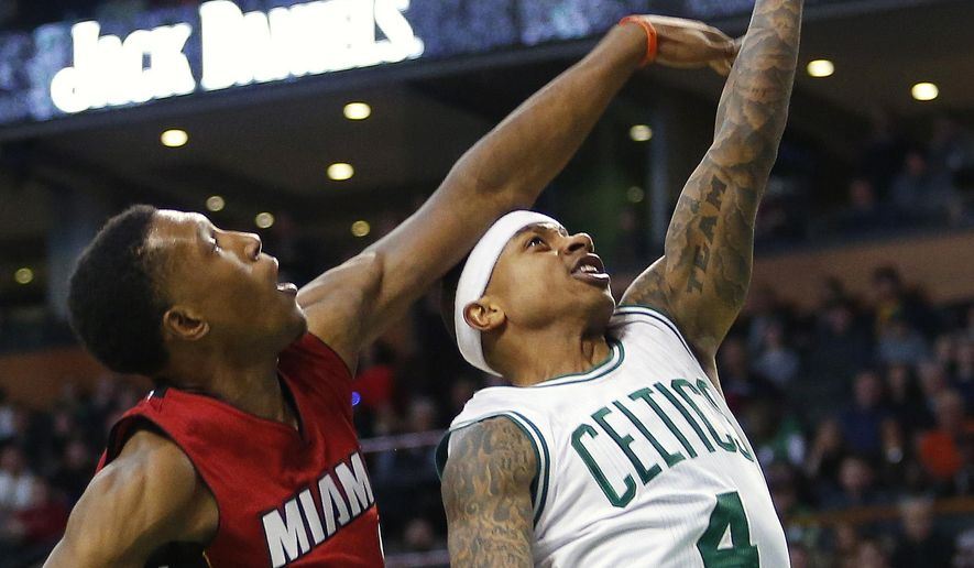 Boston Celtics' Isaiah Thomas goes to the basket past Miami Heat's Josh Richardson during the first half of an NBA basketball game in Boston Saturday, Feb. 27, 2016. (AP Photo/Winslow Townson)