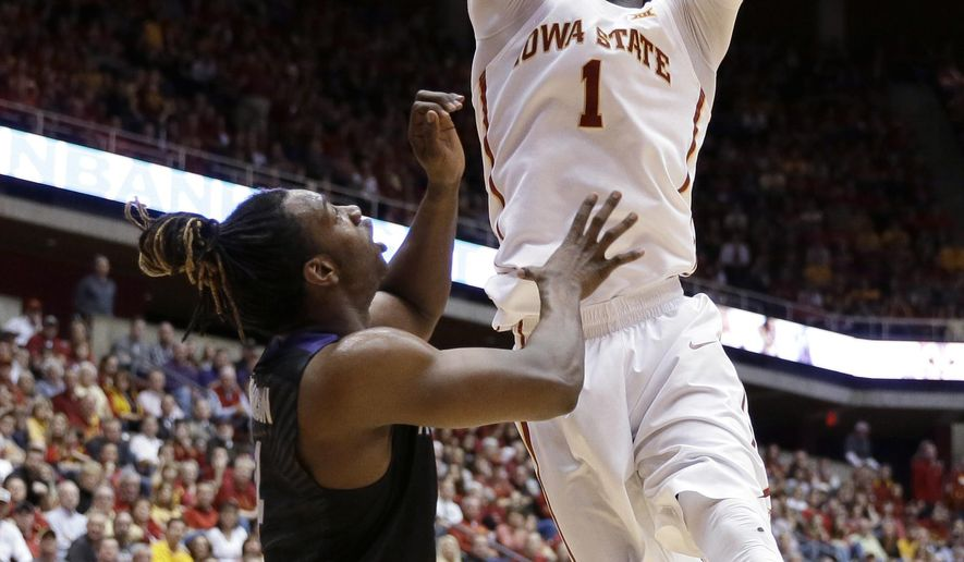 Iowa State forward Jameel McKay dunks over Kansas State forward D.J. Johnson, left, during the first half of an NCAA college basketball game Saturday, Feb. 27, 2016, in Ames, Iowa. (AP Photo/Charlie Neibergall)