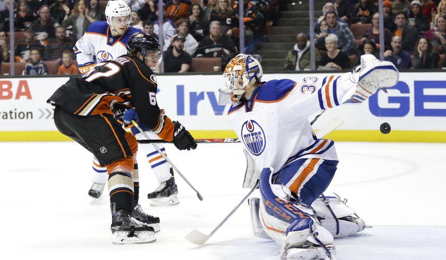 Anaheim Ducks' Rickard Rakell, left, of Sweden, scores against Edmonton Oilers goalie Cam Talbot during overtime of an NHL hockey game Friday, Feb. 26, 2016, in Anaheim, Calif. The Ducks won 2-1. (AP Photo/Jae C. Hong)