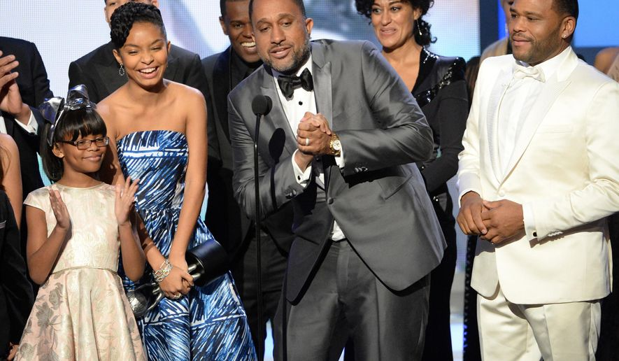 "FILE - In this Feb. 5, 2016 file photo, Marsai Martin, from left, Yara Shahidi, creator Kenya Barris, at microphone, Tracee Ellis Ross and Anthony Anderson accept the award for outstanding comedy series for ""Black-ish"" at the 47th NAACP Image Awards in Pasadena, Calif. (Photo by Phil McCarten/Invision/AP, File)"