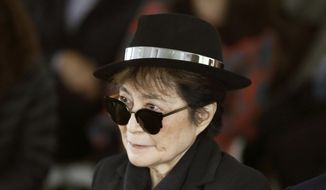 In a Friday, June 12, 2015, file photo, artist Yoko Ono appears during a ceremony announcing the future installation of Ono's first permanent public art installation in the U.S., in Chicago. (AP Photo/Charles Rex Arbogast, File)