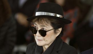 In a Friday, June 12, 2015 file photo, artist Yoko Ono appears during a ceremony announcing the future installation of Ono's first permanent public art installation in the U.S., in Chicago. (AP Photo/Charles Rex Arbogast, File)