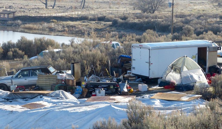 Vehicles, debris, and supplies remain Friday, Feb. 26, 2016, at what's left of Camp Finicum, the crude encampment used by the last four occupiers of the 41-day takeover of the Malheur National Wildlife Refuge outside of Burns, Oregon. Armed officers from the U.S. Fish & Wildlife Service still block access to the wildlife refuge headquarters, but they'll soon be gone as the agency takes steps to return the compound to normal. (Les Zaitz/The Oregonian/OregonLive via AP)