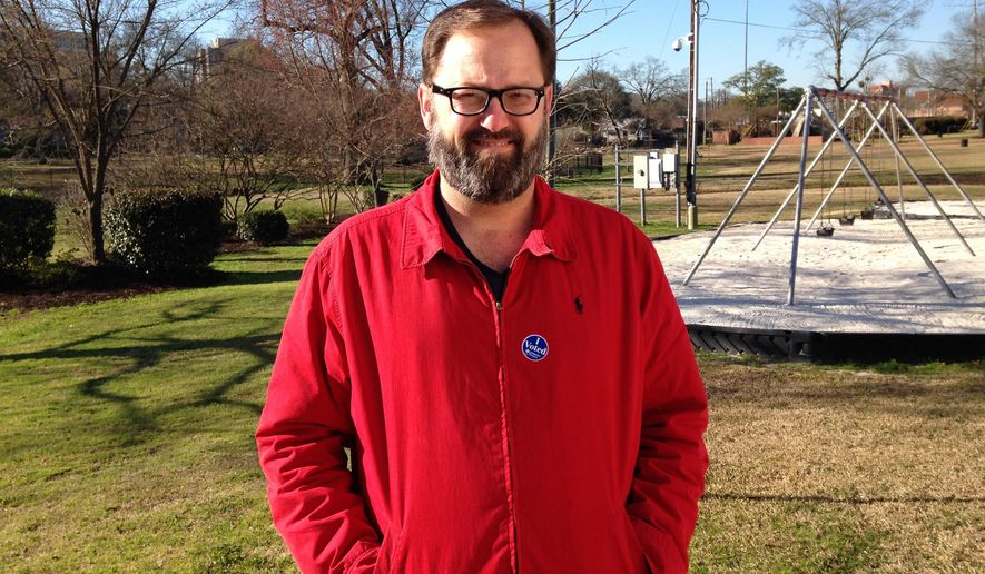 Christian Anderson stands outside the precinct where he voted for Bernie Sanders on Saturday, Feb. 27, 2016, in Columbia, S.C. Anderson is a 45-year-old college professor and said he liked Sanders support of free college education. (AP Photo/Jeffrey Collins)