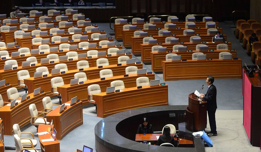 Rep. Jung Cheong Rae, right, of the main opposition Minjoo Party of Korea speaks at the National Assembly in Seoul, South Korea, Saturday, Feb. 27, 2016. South Korea's opposition lawmakers on Saturday continued their nonstop speeches for a fifth straight day in parliament to block a vote on a government-backed anti-terrorism bill that they say would threaten personal freedoms and privacy if passed into law. (Kim Hyun-tae/Yonhap via AP) KOREA OUT