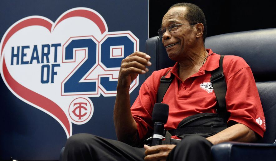 "FILE - In this Jan. 30, 2016 file photo, Hall of Famer and former Minnesota Twins baseball player Rod Carew speaks to fans about his recent heart attack during TwinsFest in Minneapolis. Carew has reached his goal of attending the Minnesota Twins first full day of spring training, five months after a massive heart attack. The players and staff all were wearing red T-shirts with a white-shaped heart in the center and the words ""Heart of 29"" in the middle. (AP Photo/Hannah Foslien)"