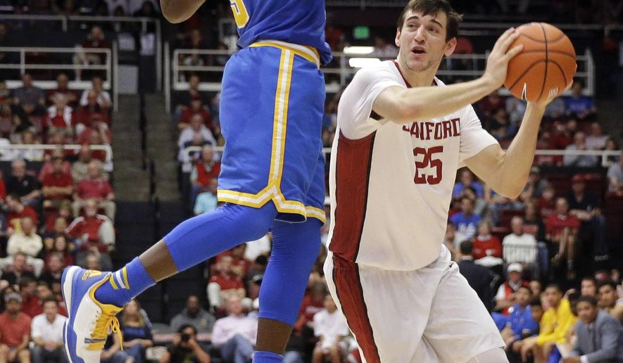 Stanford forward Rosco Allen (25) is defended by UCLA guard Aaron Holiday during the second half of an NCAA college basketball game Saturday, Feb. 27, 2016, in Stanford, Calif. Stanford won 79-70. (AP Photo/Marcio Jose Sanchez)