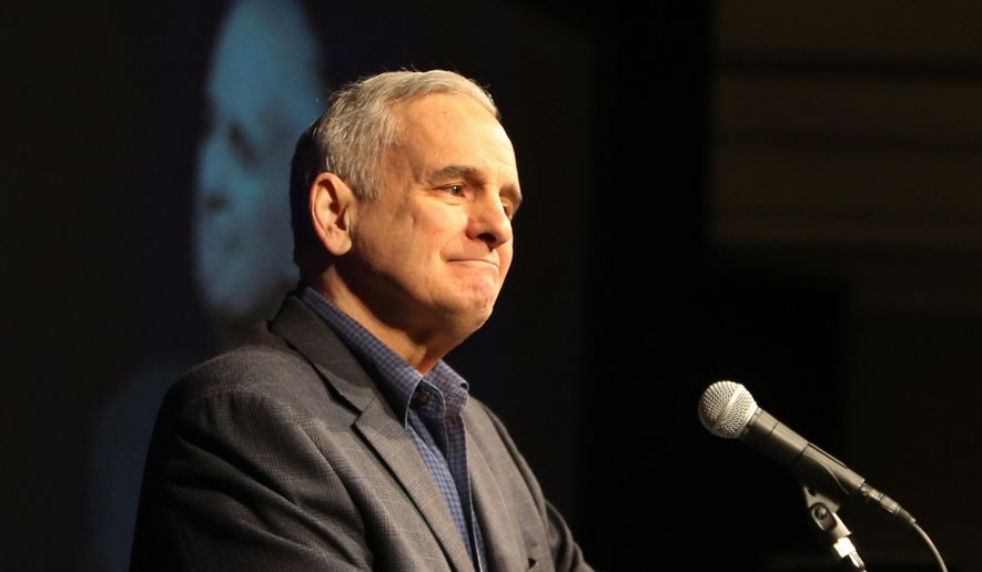 While hosting the first-ever Governor's Water Summit, Minnesota Gov. Mark Dayton's speech was briefly interrupted by protesters, some of whom asked why Native American representatives were not invited to the table and also calling to block a proposed oil pipeline through Minnesota Saturday, Feb. 27, 2016, at the InterContinental Saint Paul Riverfront. Here, Dayton paused from his speech as protesters came into the room. (David Joles/Star Tribune via AP)