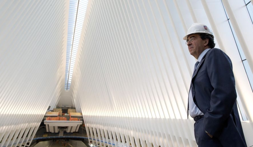 In this Thursday, Feb. 25, 2016 photo, Spanish-born architect Santiago Calatrava poses for a portrait during a media tour of the World Trade Center transportation hub in New York. The soaring, white transportation hub opening next week at the World Trade Center was designed to evoke a bird in flight, but it is hatching under a cloud. The head of the bi-state agency that controls the hub has blasted it as a symbol of excess with runaway costs approaching $4 billion. (AP Photo/Mary Altaffer)