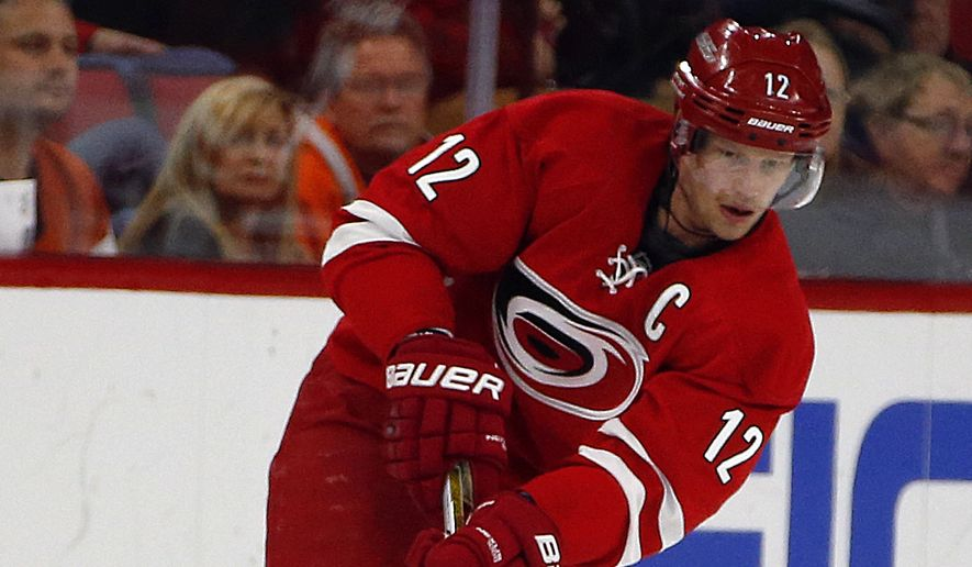 Carolina Hurricanes' Eric Staal (12) works the puck during the second period of an NHL hockey game against the Philadelphia Flyers, Saturday, Nov. 14, 2015, in Raleigh, N.C. (AP Photo/Karl B DeBlaker)