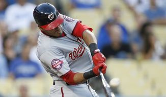 Washington Nationals' Ian Desmond hits a two-run home run to score Ryan Zimmerman against the Los Angeles Dodgers during the second inning of a baseball game, Monday, August 10, 2015, in Los Angeles. (AP Photo/Danny Moloshok)