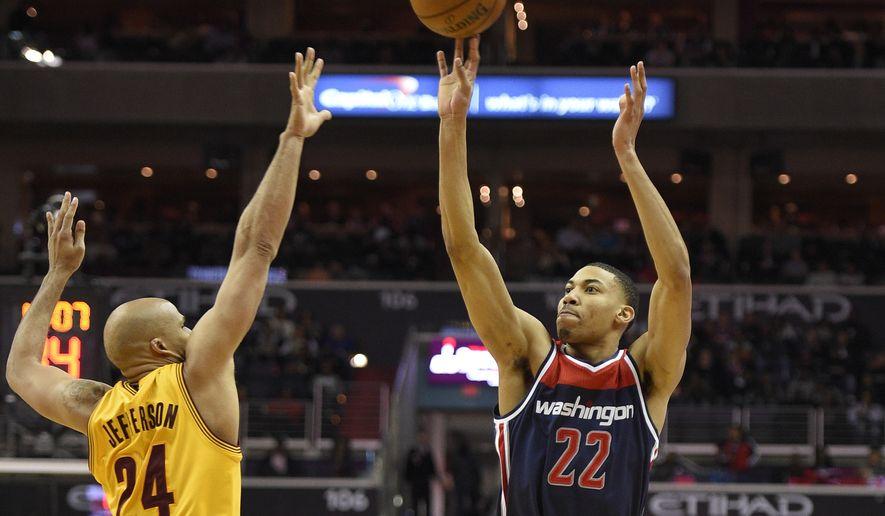 Washington Wizards forward Otto Porter (22) takes a shot against Cleveland Cavaliers forward Richard Jefferson (24) during the second half of an NBA basketball game, Sunday, Feb. 28, 2016, in Washington. The Wizards won 113-99. (AP Photo/Nick Wass)