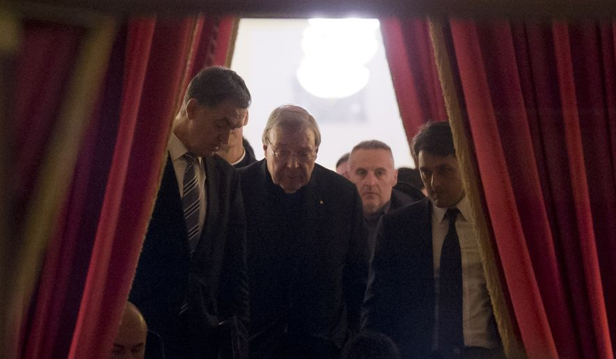 Cardinal George Pell, second from left, walks in the hall of the Quirinale hotel in Rome early Monday, Feb. 29, 2016, after he testified via videolink for four hours from the Rome hotel to the Royal Commission sitting in Sydney. (AP Photo/Alessandra Tarantino)