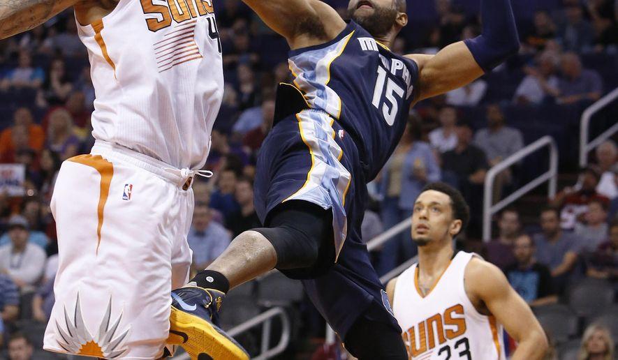 Memphis Grizzlies guard Vince Carter (15) shoots against Phoenix Suns center Tyson Chandler (4) in the second quarter during an NBA basketball game, Saturday, Feb. 27, 2016, in Phoenix. (AP Photo/Rick Scuteri)