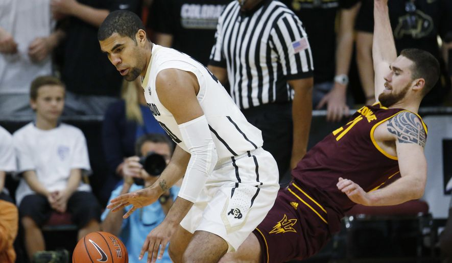 Colorado forward Josh Scott, left, knocks over Arizona State forward Eric Jacobsen while picking up the ball in the first half of an NCAA college basketball game Sunday, Feb. 28, 2016, in Boulder, Colo. (AP Photo/David Zalubowski)