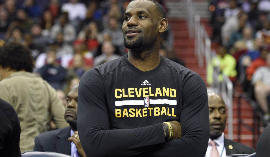 Cleveland Cavaliers forward LeBron James (23) looks on from the bench during the first half of an NBA basketball game against the Washington Wizards, Sunday, Feb. 28, 2016, in Washington. (AP Photo/Nick Wass)