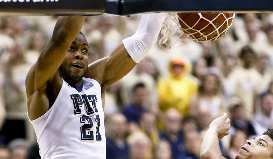 Pittsburgh's Sheldon Jeter (21) dunks past Duke's Derryck Thornton during the first half of an NCAA college basketball game, Sunday, Feb. 28, 2016, in Pittsburgh. (AP Photo/Keith Srakocic)