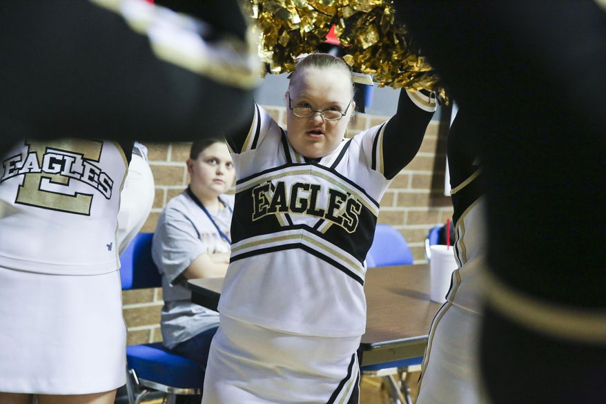 East Lawrence eighth grader Savannah Newman joins the squad for the regional championship semifinal against Deshler at Wallace State in Hanceville, Ala., on Feb. 22, 2016. East Lawrence is one of three high schools in the state with a cheerleading squad for special- needs students(Crystal Vander Weit/The Decatur Daily via AP) MANDATORY CREDIT