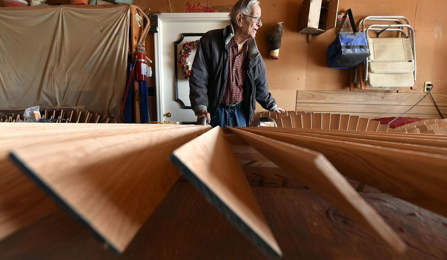FOR RELEASE SUNDAY, FEBRUARY 28, 2016, AT 12:01 A.M. CST. - Cypress blades are shown as part of a windmill head as Marvin Baker talks in the garage at his rural Pender, Nebraska, home Wednesday, Feb. 17, 2016. Baker restores and rebuilds antique agricultural windmills. (Tim Hynds/Sioux City Journal via AP)