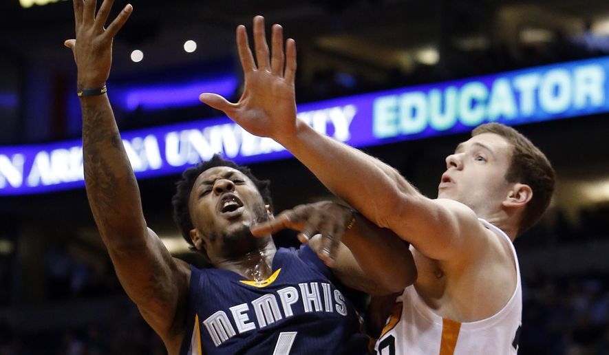 Memphis Grizzlies guard Mario Chalmers (6) draws the foul on Phoenix Suns forward Jon Leuer in the first quarter during an NBA basketball game, Saturday, Feb. 27, 2016, in Phoenix. (AP Photo/Rick Scuteri)