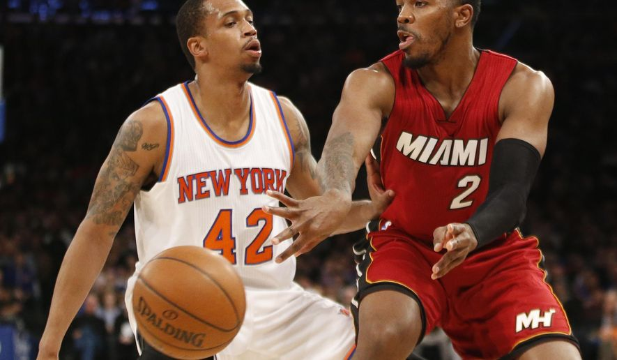 New York Knicks forward Lance Thomas (42) defends as Miami Heat forward Joe Johnson (2) passes in the first half of an NBA basketball game at Madison Square Garden in New York, Sunday, Feb. 28, 2016. (AP Photo/Kathy Willens)