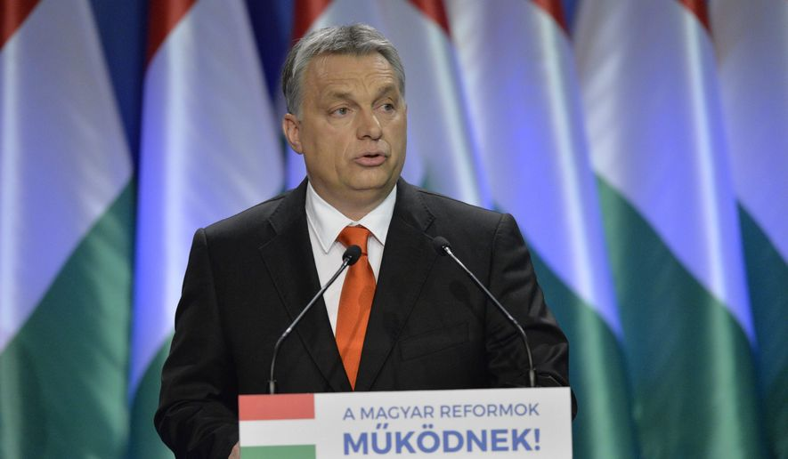 """Hungarian Prime Minister Viktor Orban delivers his annual 'State of Hungary' speech  in Budapest, Hungary, Sunday, February 28, 2016. Orban says he has ordered the interior and defense ministers to begin preparing the construction of defenses on the border with Romania to prevent migrants from entering. He also said that the European Union bureaucrats and Germany's welcoming culture are to blame for the migrant crisis on the continent. The inscription reads: """"Hungarian Reforms Are Working"""". (Szilard Koszticsak/MTI via AP)"""