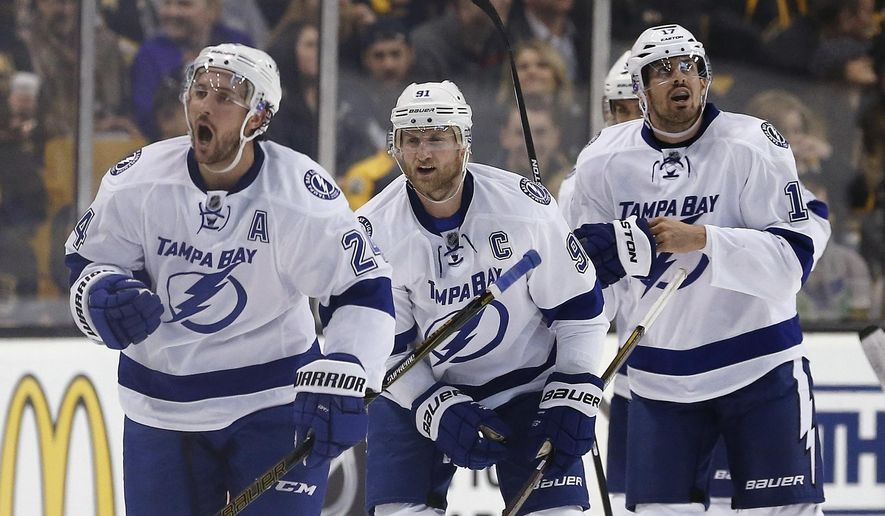 Tampa Bay Lightning's Ryan Callahan (24) celebrates his goal in front of teammates Steven Stamkos (91) and Alex Killorn (17) during the second period of an NHL hockey game against the Boston Bruins in Boston, Sunday, Feb. 28, 2016. (AP Photo/Michael Dwyer)