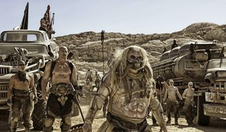 """This photo provided by Warner Bros. Pictures shows Hugh Keays-Byrne as Immortan Joe, wearing a costume by Jenny Beavan, in a scene from, """"Mad Max:Fury Road."""" Beavan is nominated for an Oscar for best costume design for her work on the 2015 film, """"Mad Max: Fury Road."""" The 88th Academy Awards will be held on Sunday, Feb. 28. (Jasin Boland/Warner Bros. Pictures via AP)"""