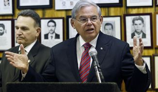 FILE - In this Feb. 18, 2016, file photo, U.S. Sen. Bob Menendez (D-NJ) speaks during a news conference, in Union City, N.J. A federal appeals court is to hear arguments in the corruption case of Menendez on Monday, Feb. 29. (AP Photo/Julio Cortez, File)