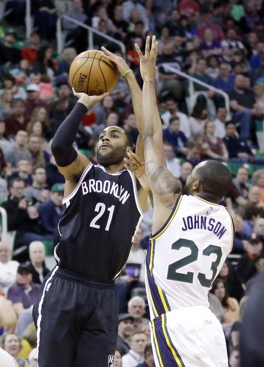 Brooklyn Nets guard Wayne Ellington (21) shoots as Utah Jazz forward Chris Johnson (23) defends during the first quarter of an NBA basketball game Saturday, Feb. 27, 2016, in Salt Lake City. (AP Photo/Rick Bowmer)