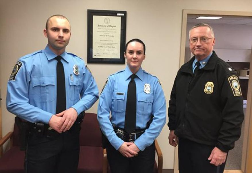A photo provided by the Prince William County Police Department shows, from the left, Officer Steven Kendall, Officer and Ashley Guindon with Lt. Col. Barry Bernard, deputy chief of the Prince William County, Va., Police Department. Officer Ashley Guindon was shot and killed Saturday, Feb. 28, 2016, and two of her colleagues were wounded in a confrontation stemming from a call about an argument. (Prince William County Police Department  via AP)