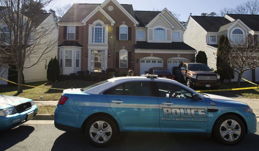 Under the Prince William County jail's policy, adopted weeks ago, someone booked on a misdemeanor will be shielded but someone booked on a felony will be held for up to two hours for ICE pickup. (AP Photo/Jose Luis Magana)