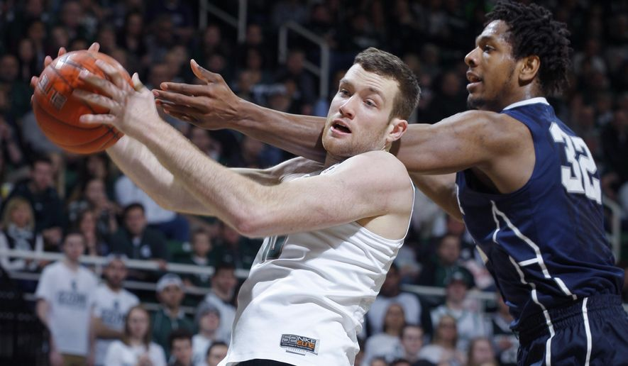 Michigan State's Matt Costello, left, grabs a rebound against Penn State's Jordan Dickerson, right, during the first half of an NCAA college basketball game, Sunday, Feb. 28, 2016, in East Lansing, Mich. (AP Photo/Al Goldis)
