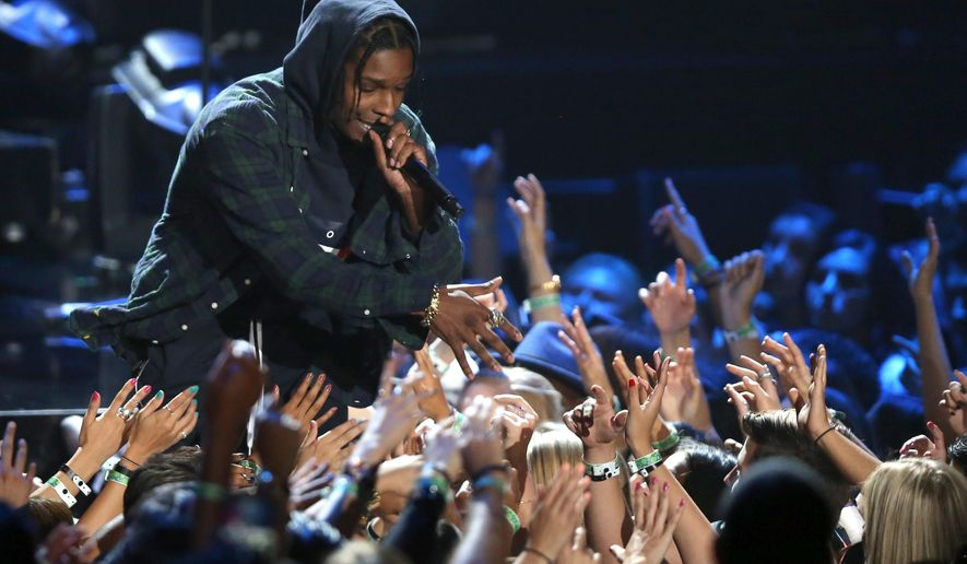 "FILE - In this Sunday, Aug. 30, 2015, file photo, A$AP Rocky performs at the MTV Video Music Awards at the Microsoft Theater in Los Angeles. Rapper A$AP Rocky says he came away unhurt during a recent attack on him inside a hotel elevator in New Zealand. Rocky told The Associated Press on Sunday, Feb. 28, 2016, that he was in a ""fist exchange"" that occurred Wednesday in Auckland, New Zealand. He performed that same day at Auckland's Vector Arena. (Photo by Matt Sayles/Invision/AP, File)"