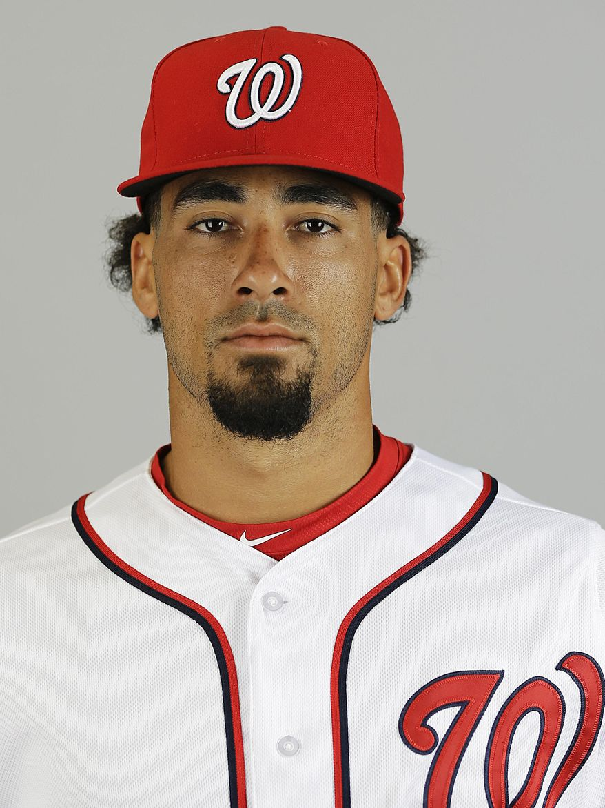 File-This is a 2015 file photo of Ian Desmond of the Washington Nationals baseball team. A baseball official with knowledge of the deal says free agent Desmond has agreed to a one-year deal with the Texas Rangers. The person spoke to The Associated Press on Sunday, Feb. 28, 2016, on the condition of anonymity because the deal, first reported by Fox Sports, is subject to the former Washington Nationals shortstop passing a physical. (AP Photo/David Goldman, File)