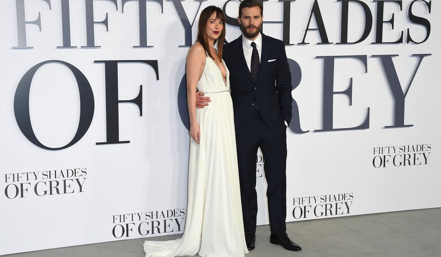 "FILE - In this Feb. 12, 2015 file photo, Dakota Johnson and Jamie Dornan pose for photographers at the UK Premiere of Fifty Shades of Grey, at a central London cinema. ""Fifty Shades of Grey"" came out on top at this year's Razzies. The  adaptation of author EL James' erotic novel nabbed five prizes at the Golden Raspberry Awards on Saturday, Feb. 27, 2016, including tying with superhero flop ""Fantastic Four"" as the year's worst film. (Photo by Jonathan Short/Invision/AP)"