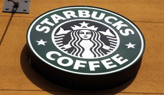 This Jan. 3, 2012, file photo, shows the Starbucks Coffee logo in Mountain View, Calif. (AP Photo/Paul Sakuma, File)