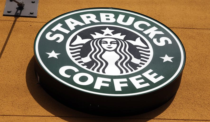 This Jan. 3, 2012, file photo, shows the Starbucks Coffee logo in Mountain View, Calif. (AP Photo/Paul Sakuma, File)