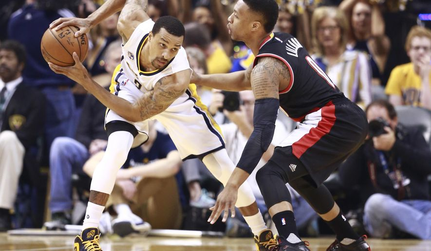 Indiana Pacers guard George Hill, left, controls the basketball defended by Portland Trail Blazers guard Damian Lillard in the first half of an NBA basketball game, Sunday, Feb. 28, 2016, in Indianapolis. (AP Photo/R Brent Smith)