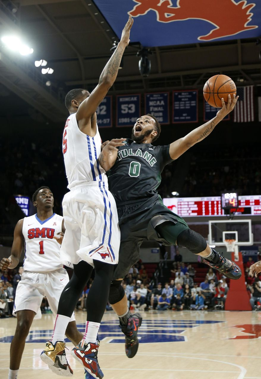 SMU's Shake Milton, left, watches as Markus Kennedy, center, attempts to block shot by Tulane's Louis Dabney, right,  in the first half of an NCAA college basketball game, Sunday, Feb. 28, 2016, in Dallas. (AP Photo/Brad Loper)