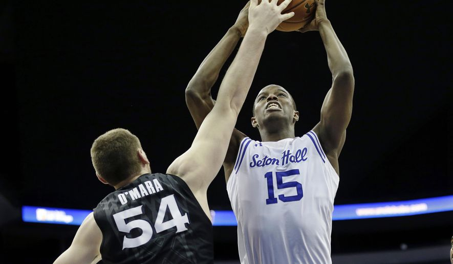 Seton Hall guard Isaiah Whitehead (15) shoots past Xavier forward Sean O'Mara (54) during the first half of an NCAA college basketball game Sunday, Feb. 28, 2016, in Newark, N.J. (AP Photo/Mel Evans)
